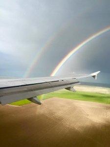 rainbow on airplane wing